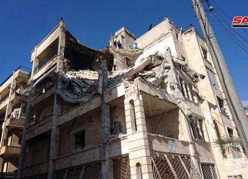 انهيار جزء من مبنى سكني في حي الزهراء بحلب نتيجة اعتداء الإرهابيين بصاروخ